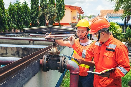Two professionals at a wastewater treatment plant